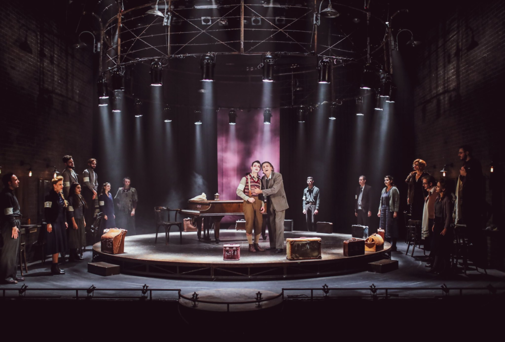 Scene from Masada 1942 - Habima Theatre, Israel. Cast on stage under lights.